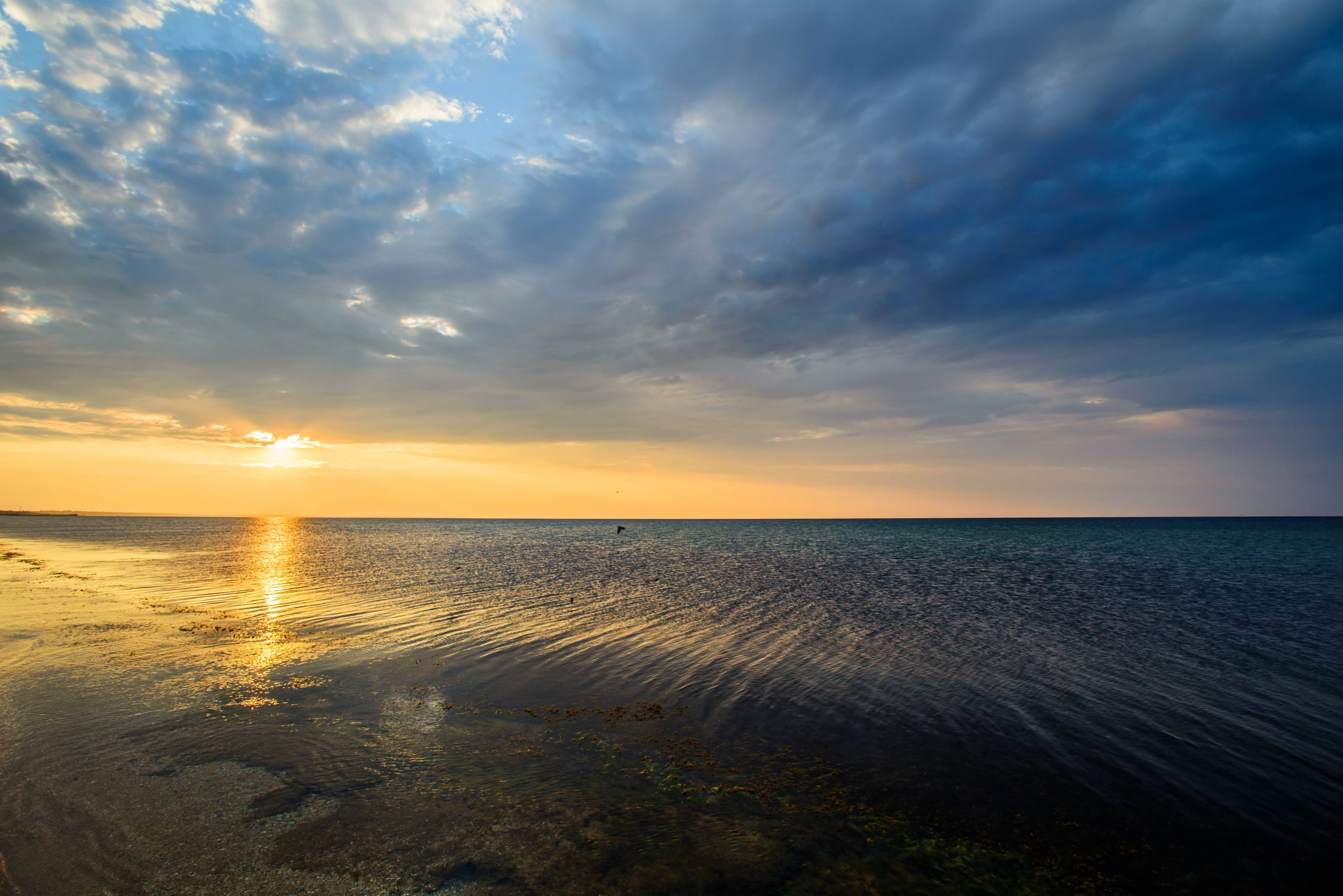The picturesque sunset over the black sea, beautiful clouds